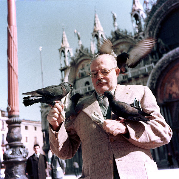 Ernest Hemingway with pigeons, Piazza San Marco, Venice, Italy, 1954.