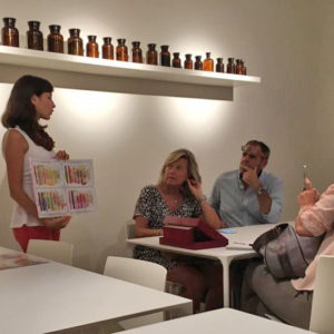 The kind guide helps visitors to learn on perfume history