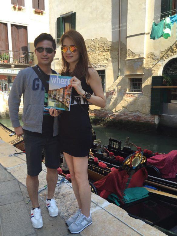 Two international travelers holding the magazine