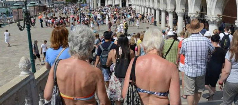 Tourists wearing a bikini in Venice